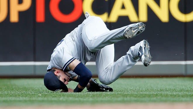 Yankees center fielder Jacoby Ellsbury does a somersault after catching a fly to center by the Twins' Chris Parmelee during the eighth inning of Saturday's game in Minneapolis.