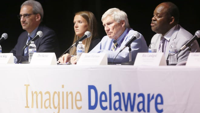 Panelists (from left) Dr. Michael Marcus of Christiana Care; Stephanie King, an addict in recovery; Don Keister, co-founder of the anti-addiction program atTAcK and James Harrison of Brandywine Counseling and Community Services take part in the Imagine Delaware forum on heroin's impact, Tuesday, June 17, 2014 at Dickinson High School.