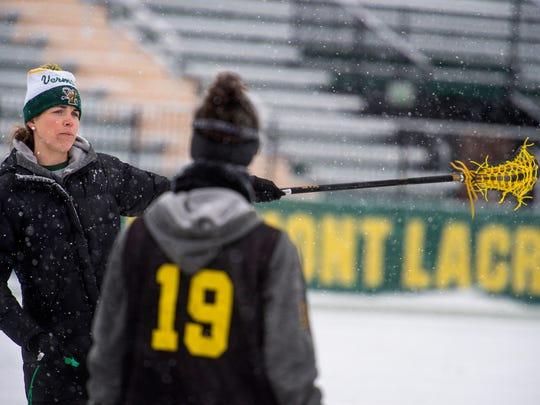 University of Vermont women's lacrosse coach Sarah Dalton runs the team through drills at practice in Burlington on Tuesday, February 1, 2017.