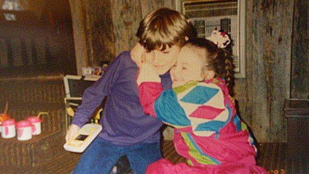 Chris Young, 7, left, with friend Molly Roberson at her 8th birthday party in 1993.