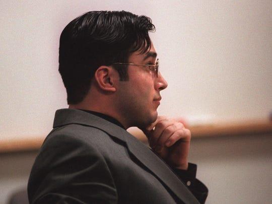 """John Ortiz-Kehoe listens as William """"Billy"""" Brown testifies"""