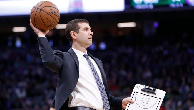 Mar 25, 2018; Sacramento, CA, USA; Boston Celtics head coach Brad Stevens holds onto the ball during a timeout against the Sacramento Kings in the third quarter at Golden 1 Center.