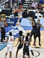 Houston Cougars guard Rob Gray scores the winning basket.
