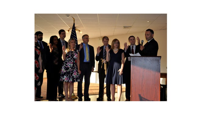 (From left) Abigail Holmes, Tariq Chaudri, Kim Barfield, Andre Araujo, Elizabeth Vogelsong, Charles Coant, Arnold Robinson, Deana Walsh, Matthew Robinson, new members of the Board of Trustees of the Cumberland County Bar Association, were sworn in recently by Hon. Benjamin C. Telsey, Assignment Judge of the Vicinage of Cumberland, Salem and Gloucester counties (far right).