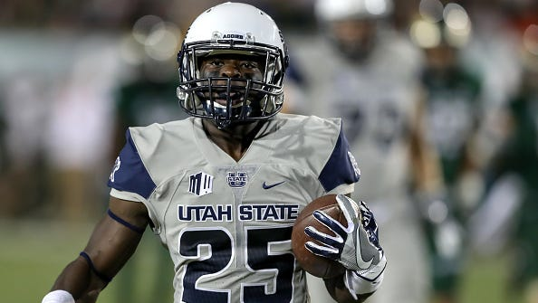 Utah State wide receiver and Escambia High grad Gerold Bright runs with the ball during a game against Colorado State in Fort Collins, Colorado, on Oct. 8, 2016.