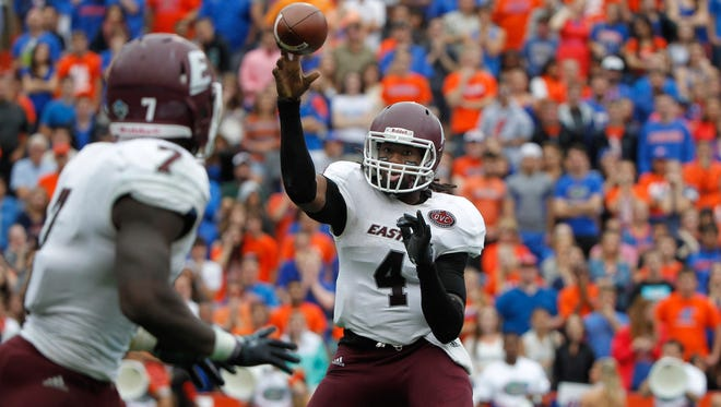 Nov 22, 2014; Gainesville, FL, USA; Eastern Kentucky Colonels quarterback Bennie Coney (4) throws the ball to running back Dy'Shawn Mobley (7) during the second quarter at Ben Hill Griffin Stadium.