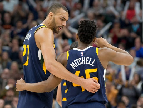 Rudy Gobert and Donovan Mitchell react during a timeout