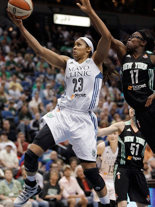 Minnesota Lynx guard Maya Moore (33) shoots against New York Liberty guard Essence Carson (17) during the second half of a WNBA basketball game, Saturday, May 24, 2014, in Minneapolis. Moore scored 30 points as the Lynx won 87-82. (AP Photo/Stacy Bengs)
