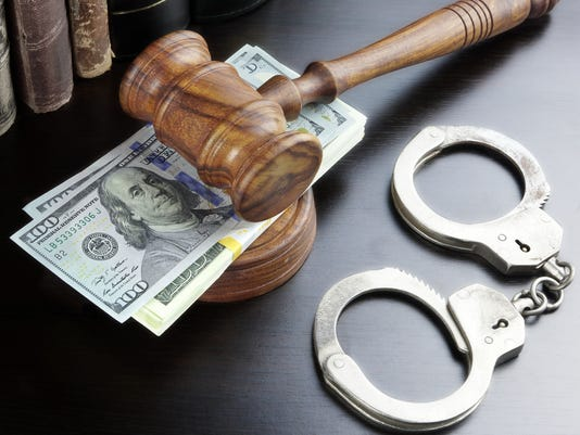Judges Gavel, Handcuffs, Dollar Cash And Book On  Black Table