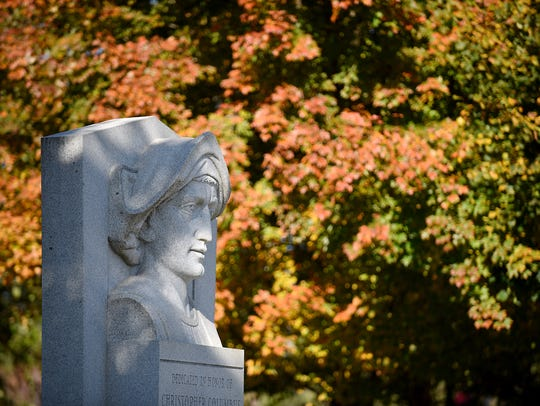 A sculpture of Christopher Columbus on a fall day at