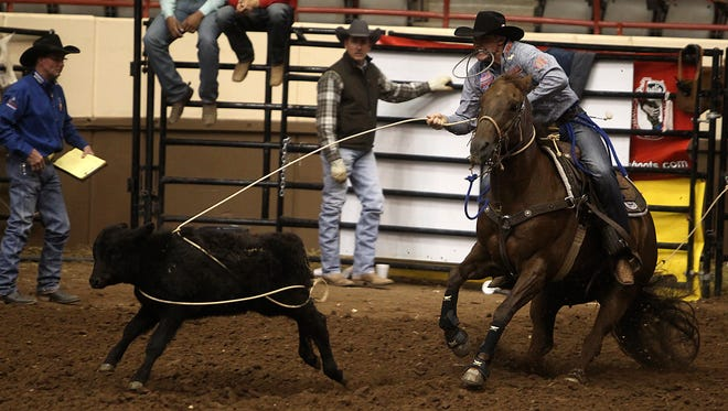 Tuf Cooper quickly ropes his calf during the Tie-Down Roping competition on Day 1 of Slack Tuesday, February 7, 2017. Cooper tied first with Michael Otero.