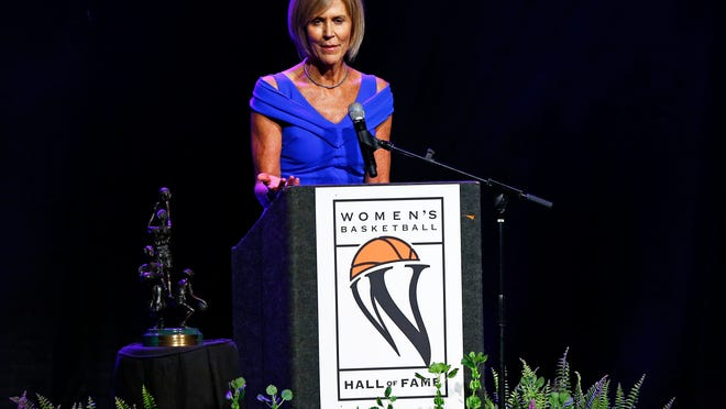 Connecticut assistant coach Chris Dailey speaks during induction ceremonies at the Women's Basketball Hall of Fame on Saturday, June 9, 2018, in Knoxville, Tenn. (AP Photo/Wade Payne)