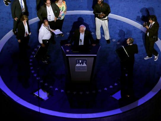 Sen. Bernie Sanders (I-VT) stands on stage prior to