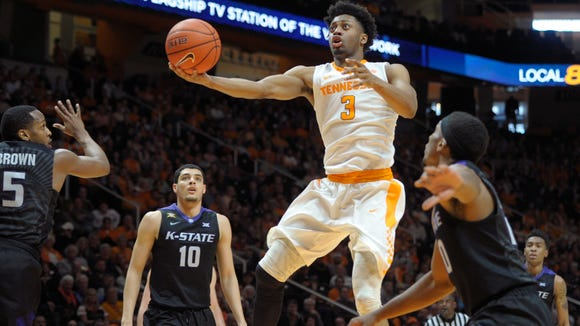 Tennessee's Robert Hubbs III (3) goes for a layup during an NCAA SEC-Big 12 basketball game between Tennessee and Kansas State at Thompson-Boling Arena in Knoxville, Tenn., on Saturday, January 28, 2017. (Calvin Mattheis/Knoxville News Sentinel via AP)