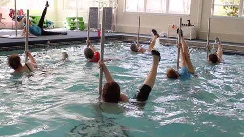 Seniors Strip Down For Pool Fitness On The Pole