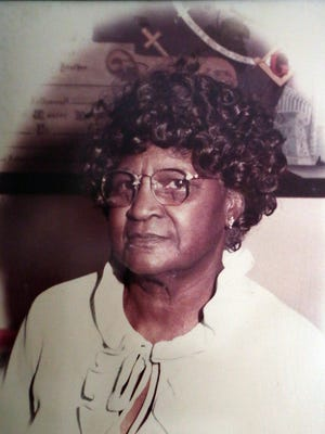 A photo of Jeralean Talley, 113, of Inkster during her younger days hangs on the wall of her living room.