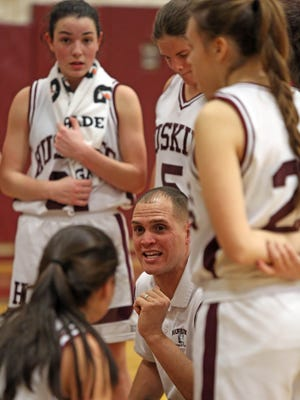 Harrison coach, Louis Kail talks with his team during game action against Eastchester High School during game action at Harrison High School on Jan. 20, 2016. Harrison defeated Eastchester 68-63.