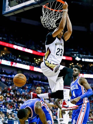 Pelicans forward Anthony Davis dunks over 76ers forward Jerami Grant during the first quarter Friday.