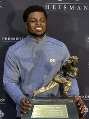 Heisman Trophy finalist Jabrill Peppers poses with the award in New York, Friday, Dec. 9, 2016.