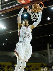 New Mexico State's Matt Taylor dunks the ball during Thursday's WAC men's basketball game at the Pan American Center. For more photos from Thursday's game, click on this story at lcsun-news.com.