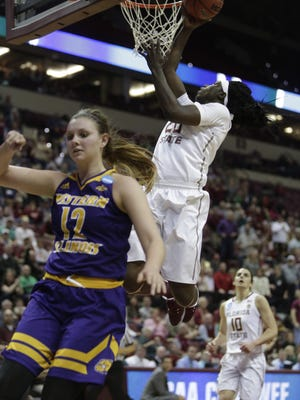 Florida State forward Shakayla Thomas makes a basket during FSU's game with Western Illinois in first round of the NCAA championship at the Donald L Tucker Civic Center Friday.