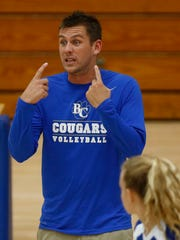 Barron Collier's Head Coach Robert Ritchie talks to his team during the third and final set Wednesday, Oct. 28, 2015 at Barron Collier High School in Naples, Fla. The Cougars faced off against the Wildcats in a Class 6A regional quarterfinal championship matchup. Barron Collier cruised to a victory 25-11, 25-23, 25-9.