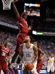 Kentucky forward Willie Cauley-Stein (15) eyes the basket under Arkansas' leaping Bobby Portis (10) during Saturday's game in Lexington, Ky. Portis and the No. 18 Razorbacks look to rebound from an 84-67 loss to the No. 1 Wildcats tonight at South Carolina.