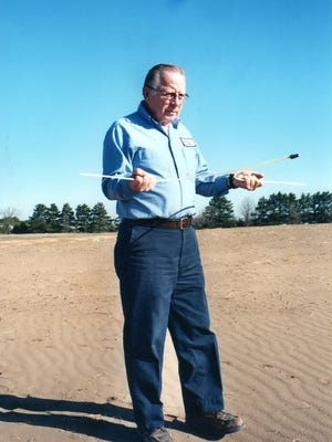 Jim Kuebelbeck of St. Joseph uses a nylon, two-pronged rod for water dowsing.