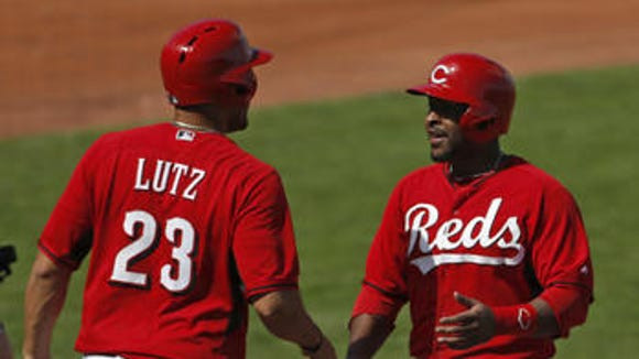 Chris Nelson (left) has reportedly opted out of his contract with the Reds.