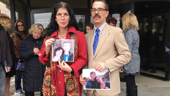 Kayla Donaldson and Jason Sullivan hold photos of their son, Ambrose Ian Sullivan, following a court hearing Nov. 9, 2017. David Vega was sentenced to seven months in Livingston County Jail for the 2016 crash that resulted in Ambrose Sullivan's death.