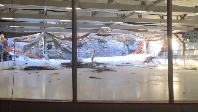 This photo provided by the Canton Police Department and taken by Chief Ken Berkowitz shows the rear portion of the roof that collapsed at the Metropolis Skating Rink on Saturday, Feb. 28, 2015 in Canton, Mass.