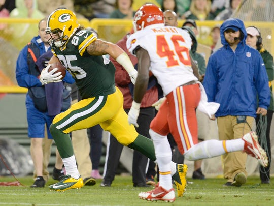 Green Bay Packers tight end Jake Stoneburner (85) runs after a catch against the Kansas City Chiefs at Lambeau Field.