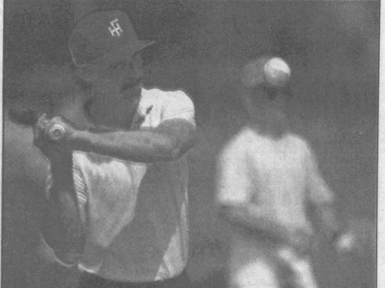 Florida High baseball coach John Hollenbeck hits infield practice during his first year as head coach in 1994.