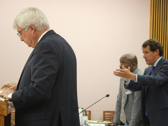 Attorney William Applegate IV speaks in court Wednesday on behalf of the WInbush family, which is involved in a land dispute with the city of Anderson, while his co-counsel  Garryl Deas and the city's lawyer, James Logan Jr., listen.