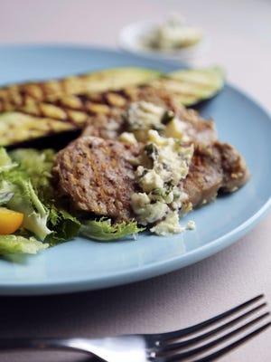 Pork cutlets with zucchini and oregano. Feta butter.