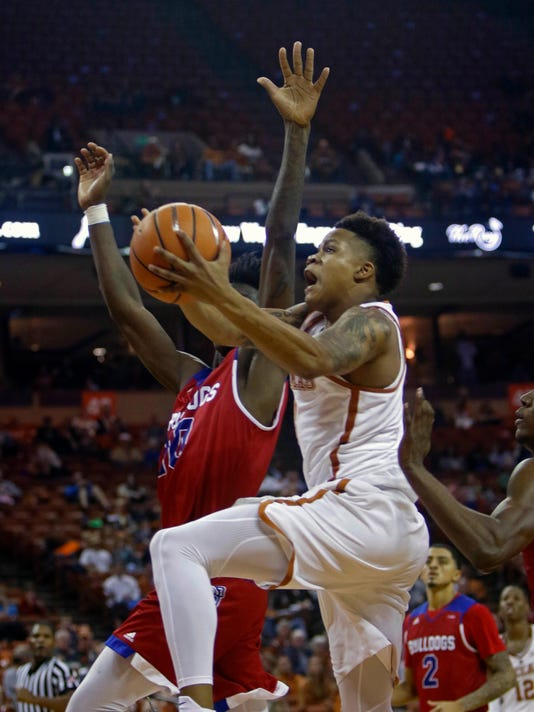 Texas guard Jacob Young, front, drives to the basket against Louisiana Tech guard Anthony Duruji, back, during the second half of an NCAA college basketball game, Saturday, Dec. 16, 2017, in Austin, Texas. Texas won 75-60. (AP Photo/Michael Thomas)