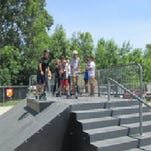 Skaters wait their turns during the Summer Jam at the St. Clair Skatepark.