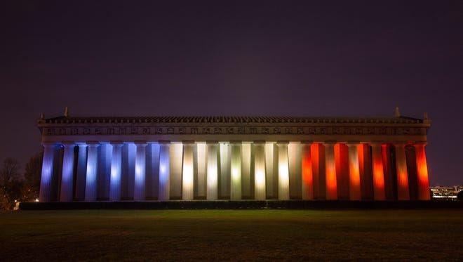 The Parthenon in Nashville shines in the colors of the French flag Sunday.