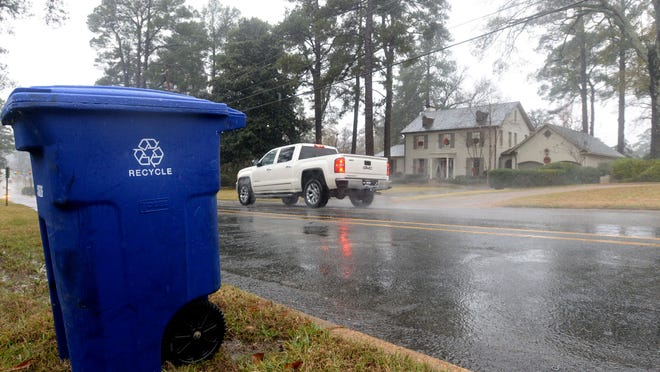 A blue recycle bin waits for pick up on Fairfield Ave.