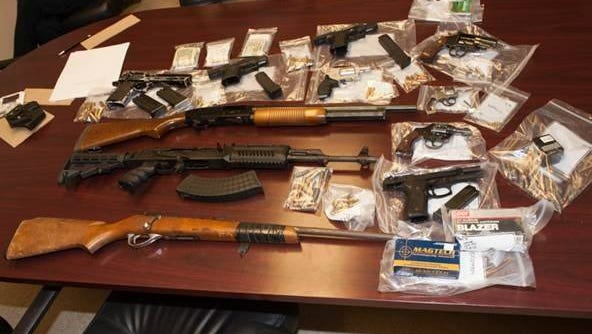 Escambia Sheriff's Investigators have arrested five individuals (including one juvenile) and seized a large quantity of weapons and narcotics following a lengthy investigation of two Kelly Avenue homes.