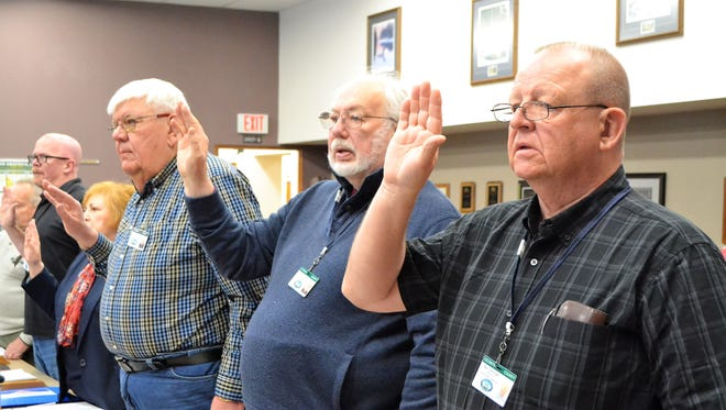From right, new Oconto County Board supervisors Bart Schindel and Dick Doeren take the oath of office at the April 17 reorganizational meeting. Farther left are Karl Ballestad, Rose Stellmacher and new member David Parmentier.