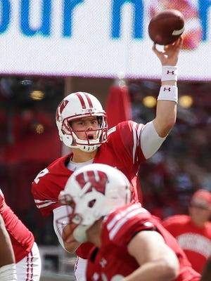 Wisconsin Badgers quarterback Alex Hornibrook (12) hits Wisconsin Badgers wide receiver Jazz Peavy (11) for a first down in the 4th quarter during Wisconsin's 23-17 win over Georgia State  during the NCAA football  game Saturday, September 17, 2016, at Camp Randall Stadium in Madison, Wis. Milwaukee Journal Sentinel photo by Rick Wood/RWOOD@JOURNALSENTINEL.COM ORG XMIT: 00089497A