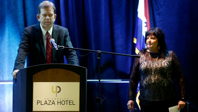 Gregg Groves, John Q. Hammons Hotels & Resorts senior vice president and general counsel, stands next to CEO Jacqueline Dowdy during a press conference at the company's University Plaza Hotel and Conference Center in Springfield about the company filing for bankruptcy.
