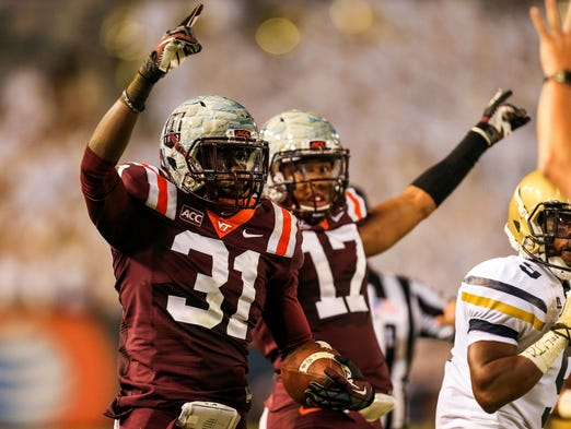 Virginia Tech Hokies cornerback Brandon Facyson (31) celebrates an interception in the first half against the Georgia Tech Yellow Jackets at Bobby Dodd Stadium.