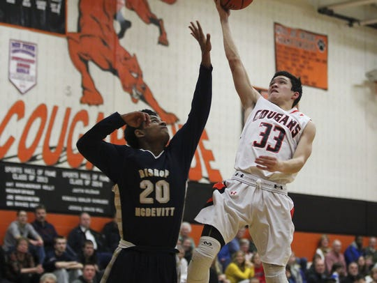 Palmyra's Sam Sheils goes up for a layup during the