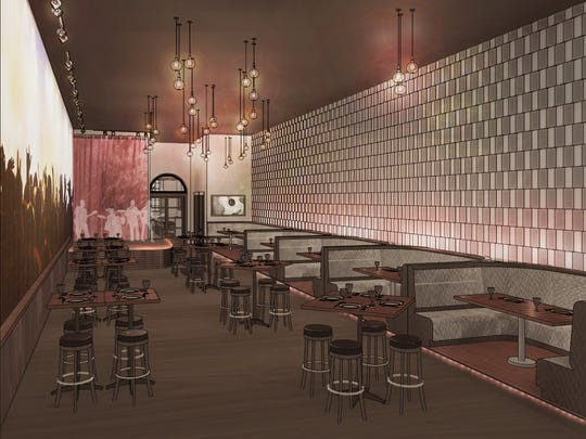 A stage area for live music performances and VIP booths at Almost Famous
