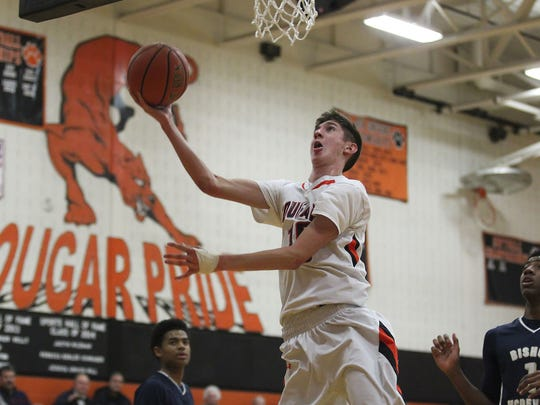 Palmyra junior Isaac Blatt scores during the Cougars' 70-56 home win over Bishop McDevitt on Tuesday, their seventh in a row.