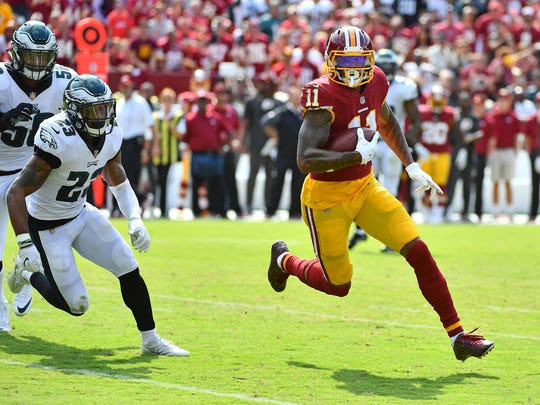 Washington Redskins wide receiver Terrelle Pryor (11) runs after a catch as Philadelphia Eagles free safety Rodney McLeod (23) chases during the second half at FedEx Field.