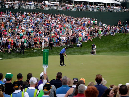 Webb Simpson hits on the second playoff hole during the final round of the Waste Management Phoenix Open golf tournament, Sunday, Feb. 5, 2017, in Scottsdale, Ariz. (AP Photo/Matt York)