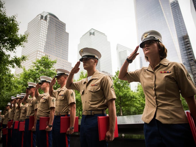 Members of the U.S. Marine Corps salute during a promotion ceremony at the National September 11 Memorial on May 23, 2014 in New York City. The ceremony took place in coordination with Fleet Week.